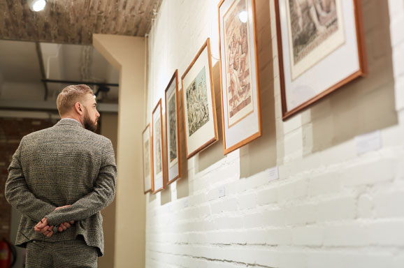 Man viewing artwork.